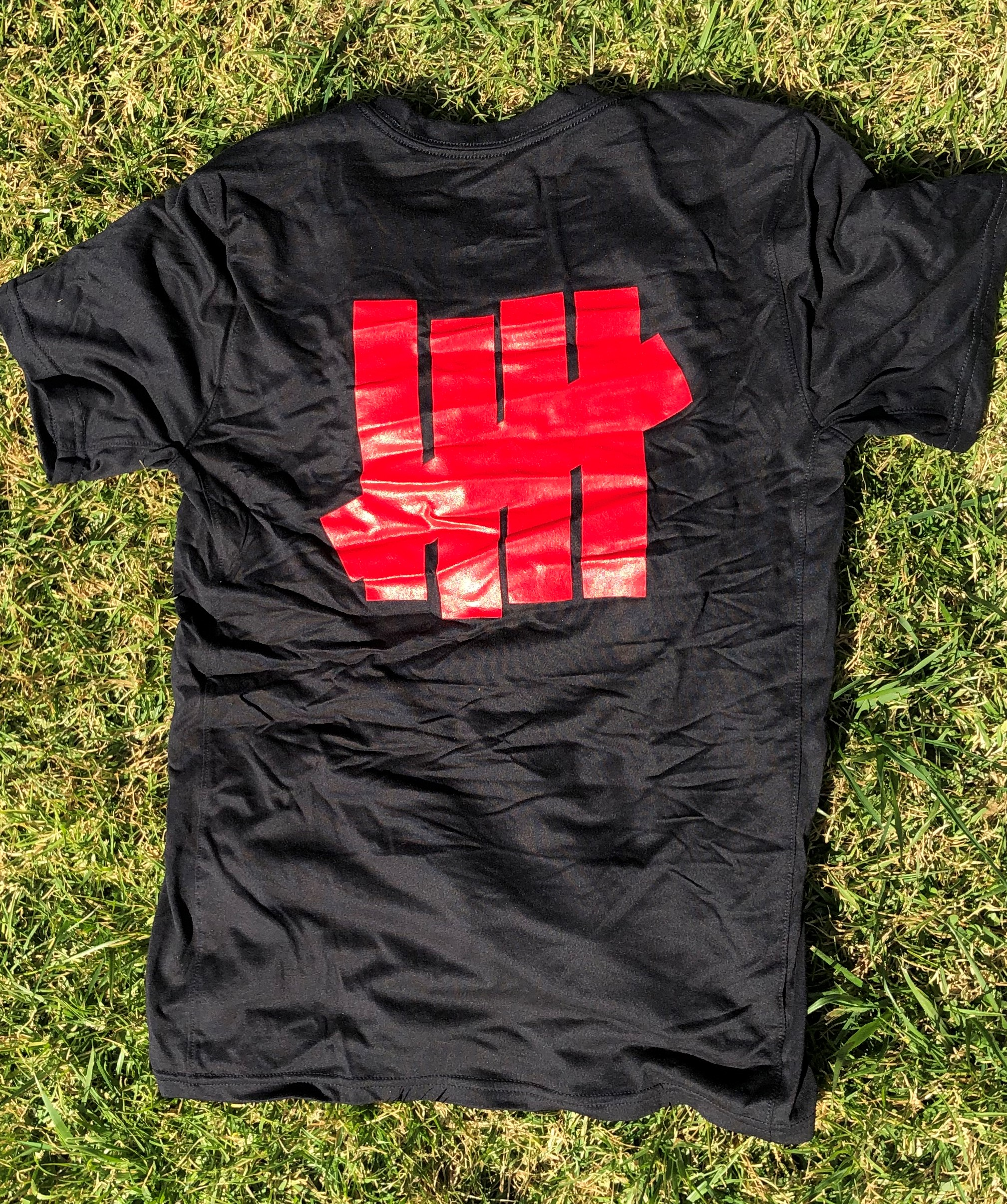black T-shirt back with roman numeral in red