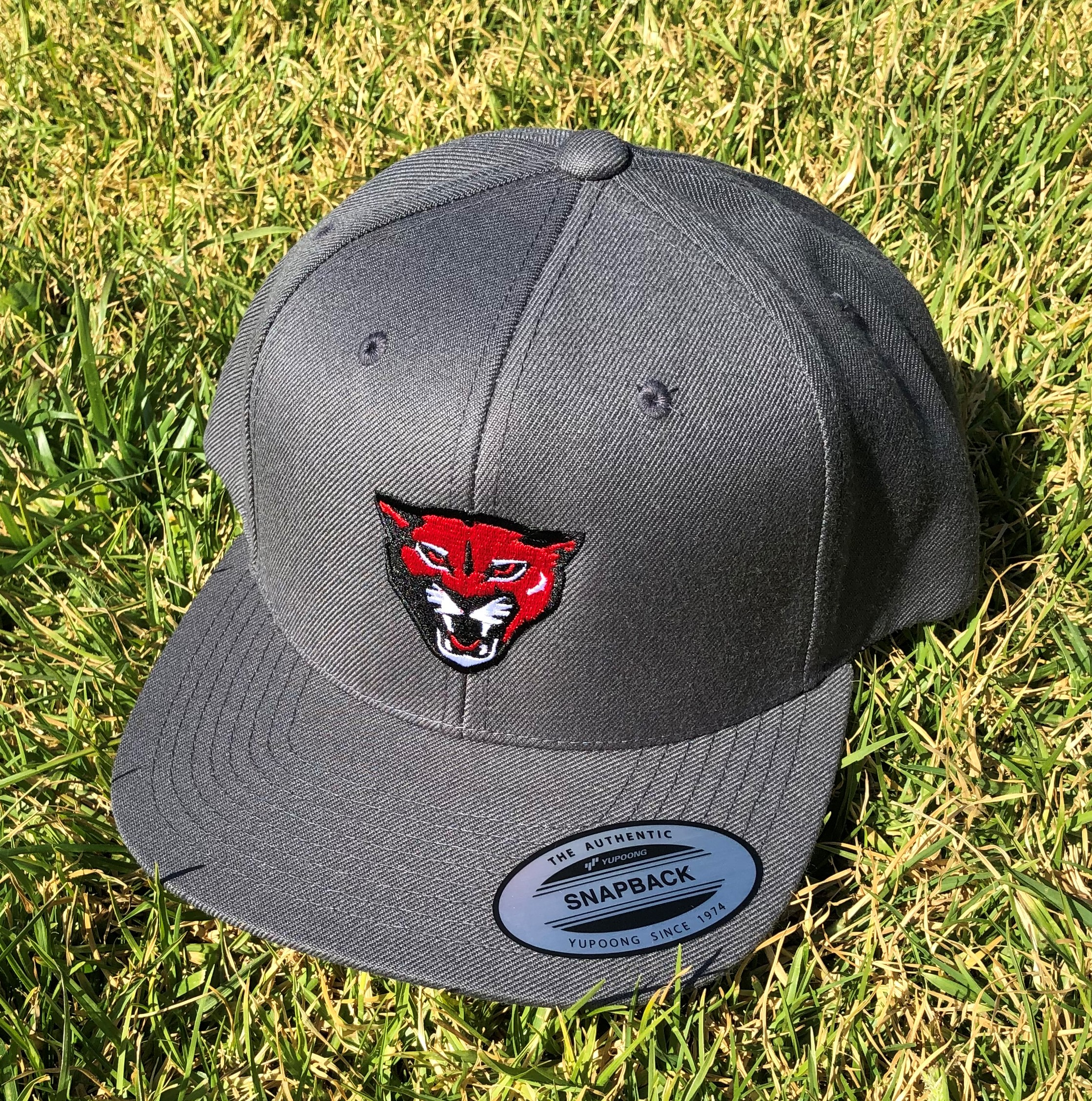 grey baseball cap with red cougar face