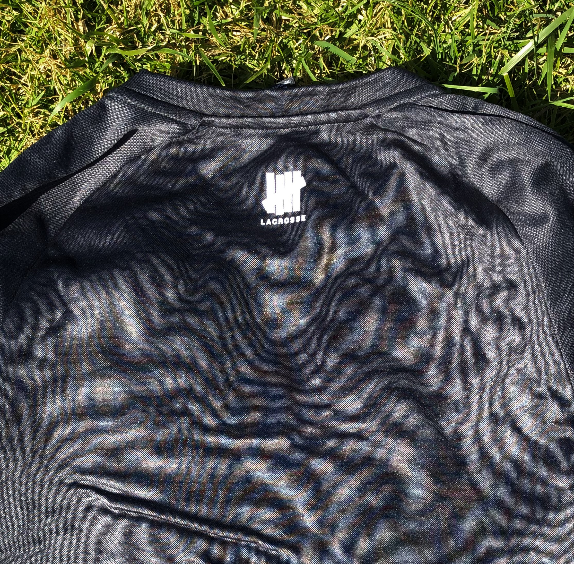 grey shirt back with roman numeral