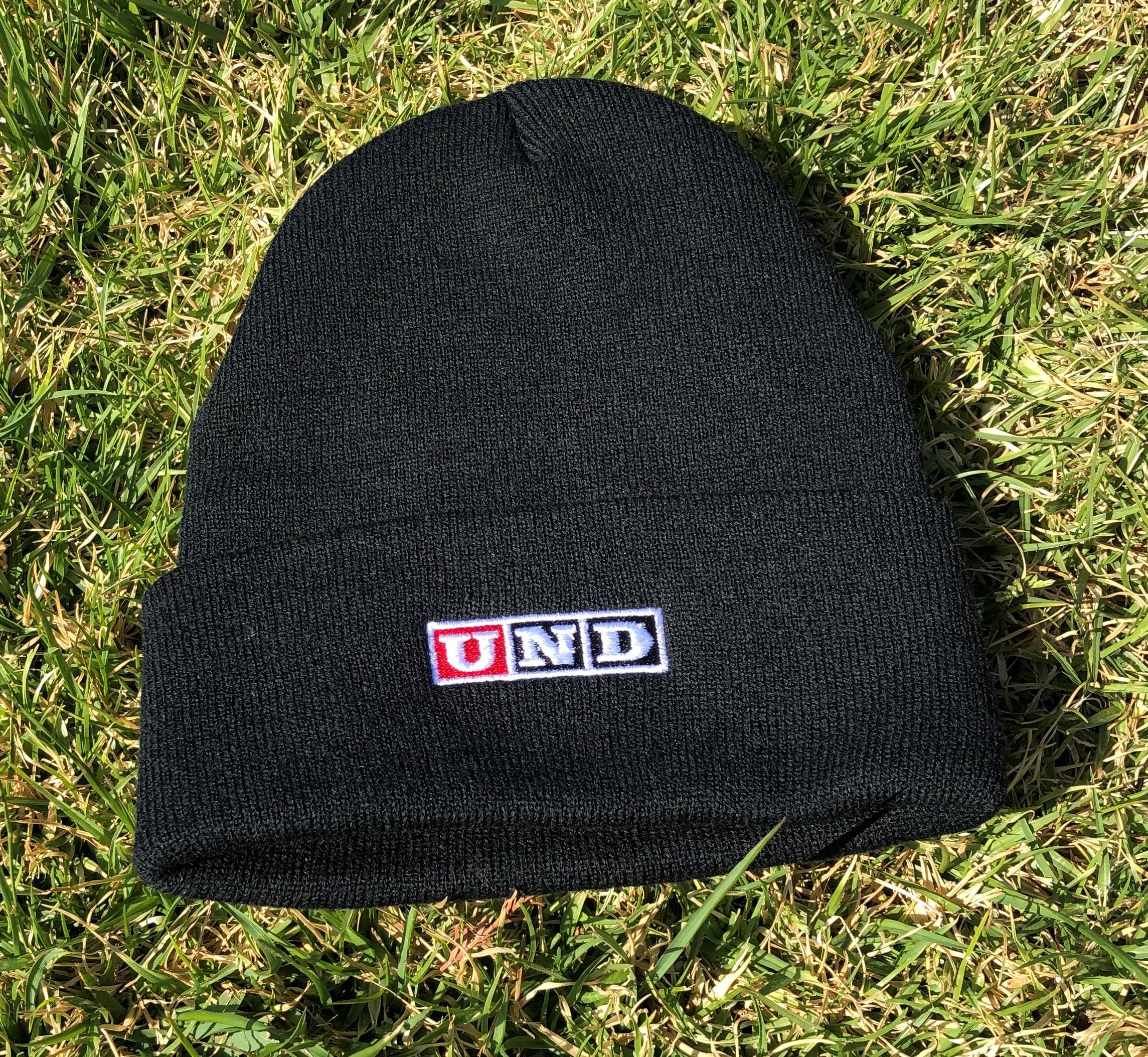 black cap with UND logo