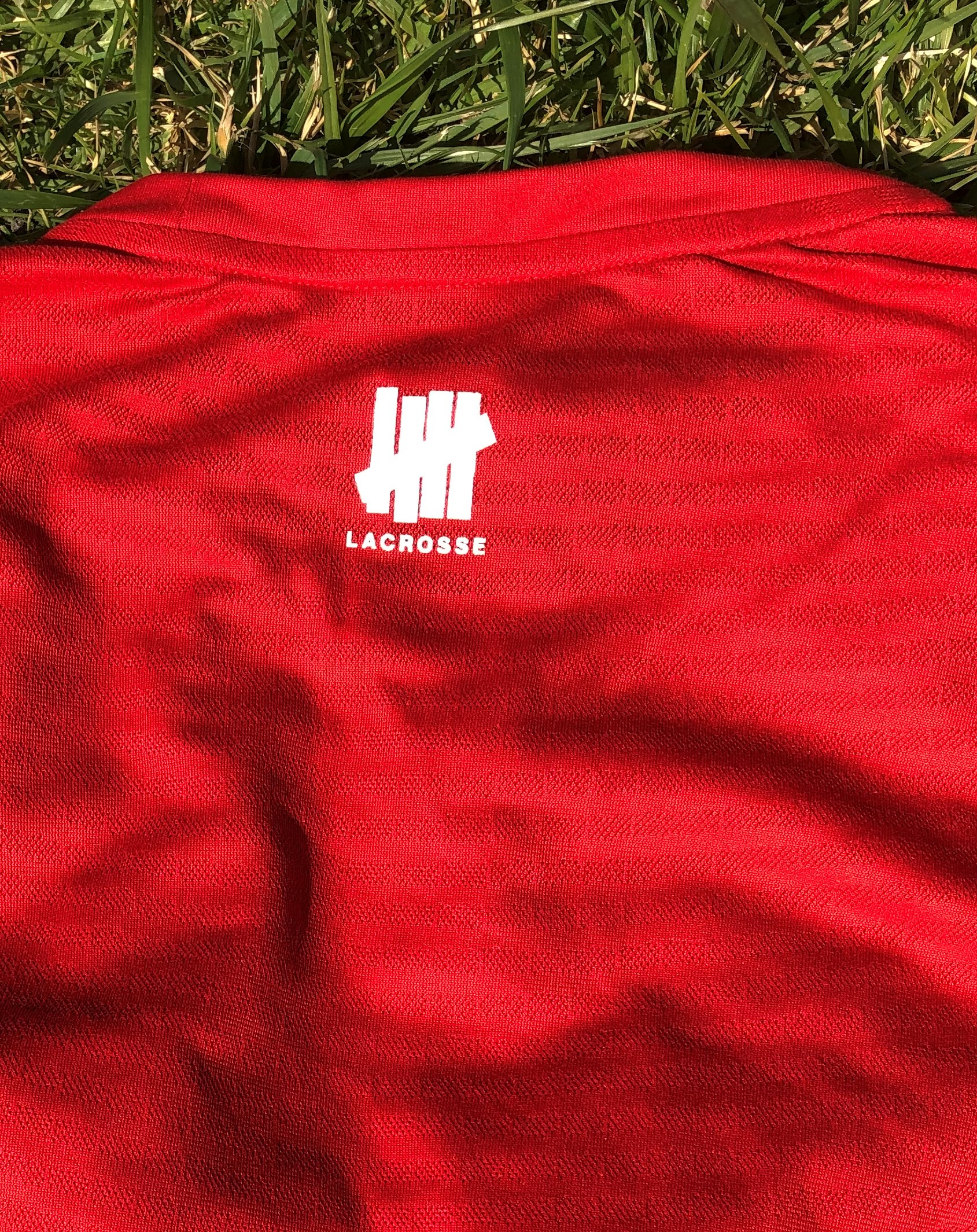 red shirt back with roman numeral logo